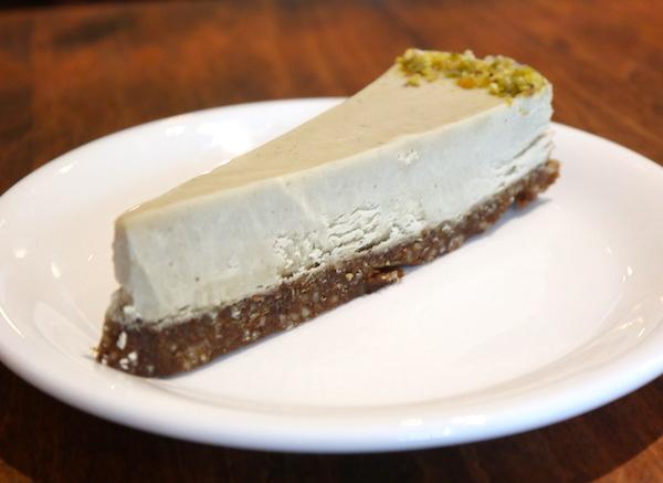 a thin wedge of cheesecake